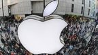 Apple logo with public shoppers outside