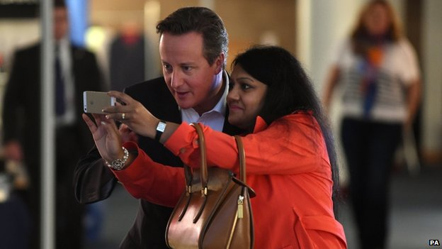 Prime Minister David Cameron poses for a selfie with Conservative Women's Hub member Parveer Hasan