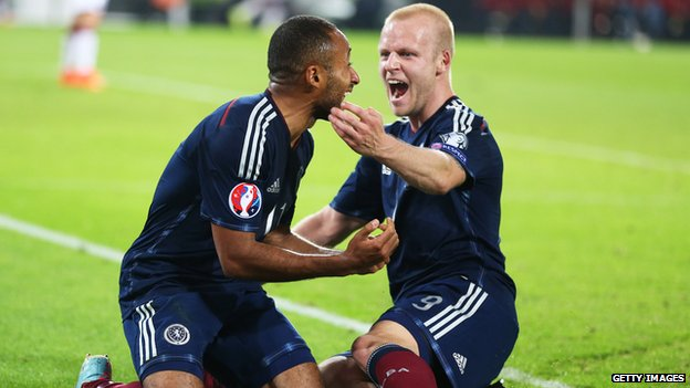Ikechi Anya celebrates his goal against Germany with Scotland team-mate Steven Naismith