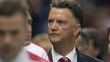 Louis van Gaal (centre) looks to the crowd as he walks alongside his squad