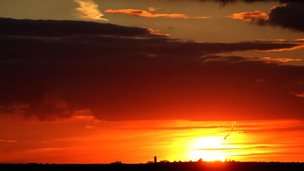 The sun sets over a field near Cambridge on September 26