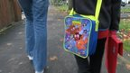 Child walking with pack lunch bag