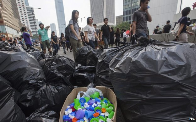 Plastic bottle tops are seen separated for recycling by students