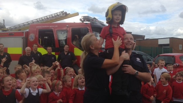 Liam, with a fire crew and pupils