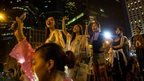 Protesters sing songs and wave their mobiles in the air in Hong Kong