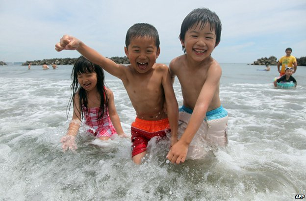 Children playing in the sea in Japan