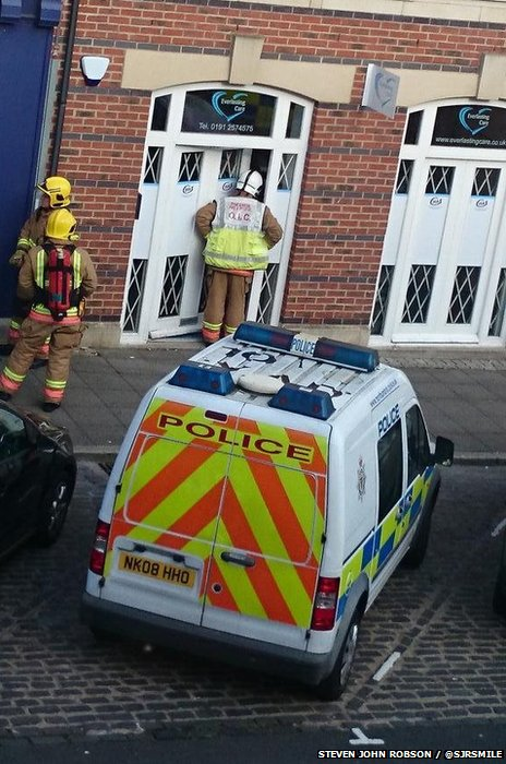 Fireman at the door of