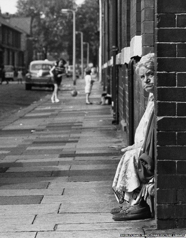 Old Lady sitting in a doorway, Manchester 1968