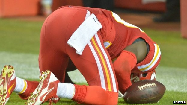Husain Abdullah kneels in prayer