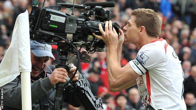 Liverpool captain Steven Gerrard kisses a TV camera during a Premier League match