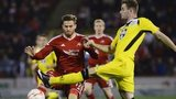 David Goodwillie challanges for the ball with Jason Naismith