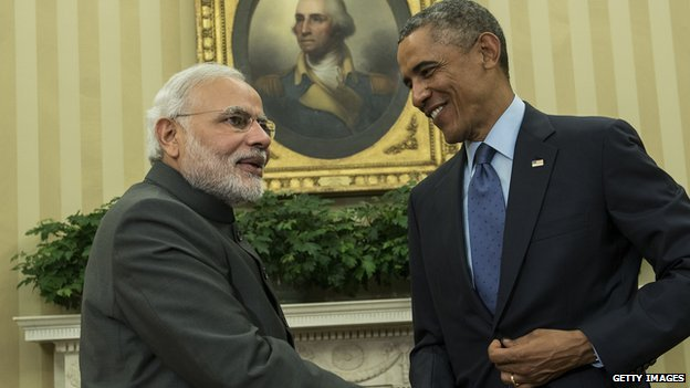 Indian Prime Minister Narendra Modi and Barack Obama shake hands in the White House.