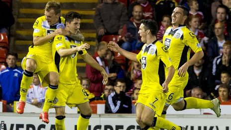 Kenny McLean takes the plaudits from his St Mirren team-mates after netting the late leveller