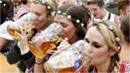 Visitors enjoy beer during visit to Oktoberfest