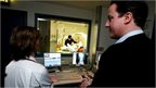 David Cameron watches a patient having an X-ray