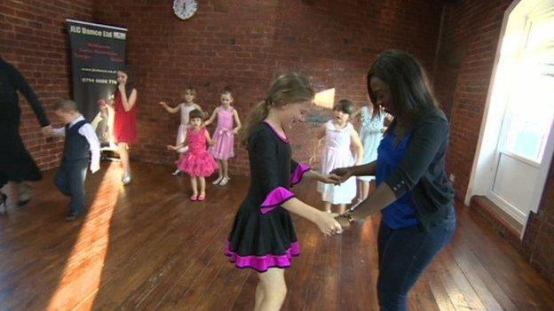 Ayshah taking a ballroom dancing lesson