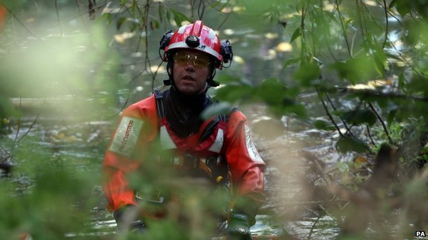 Emergency teams search the river
