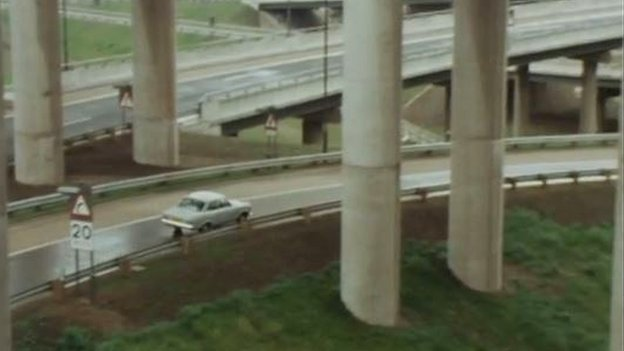 Car driving on spaghetti junction in 1972