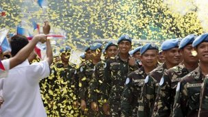 Peacekeeping troops from the Philippines return to a hero's welcome