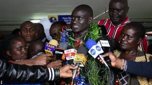Dennis Kimetto is mobbed by the media on his return to Kenya