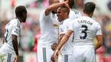 Swansea City celebrate a goal during their win over West Brom