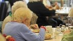 Elderly people eating