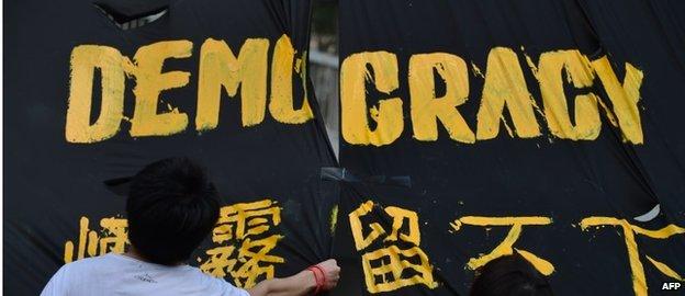 Protesters hang a banner in Hong Kong