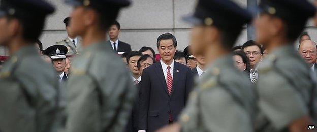 Hong Kong Chief Executive CY Leung watches a military parade (1 Oct 2014)