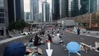 Pro-democracy demonstrators rest after overnight protests near the Hong Kong government headquarters on 2 October 2014