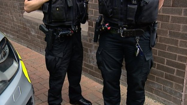 Police officers with firearms