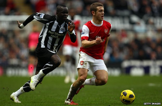 Jack Wilshire of Arsenal battles with Cheick Tiote of Newcastle
