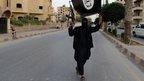 An IS member in Raqqa, Iraq (29 June 2014)