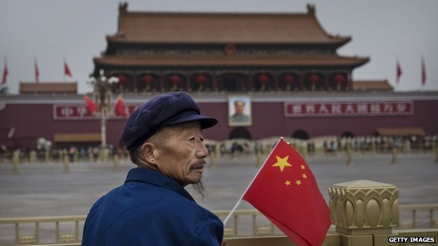 Man with flag in Beijing on China's 65th National Day, 1 October, 2014