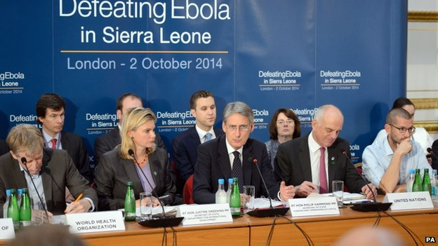 """Foreign Secretary Philip Hammond (fifth right) addresses delegates at the """"Defeating Ebola in Sierra Leone"""" conference at Lancaster House in London on 2 October 2014"""