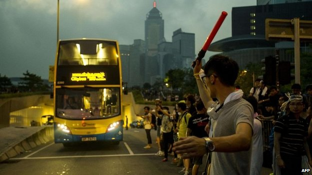 Pro-democracy protesters keep a road open outside government offices in Hong Kong on 3 October 2014
