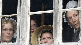 Cranford actresses peering out of window