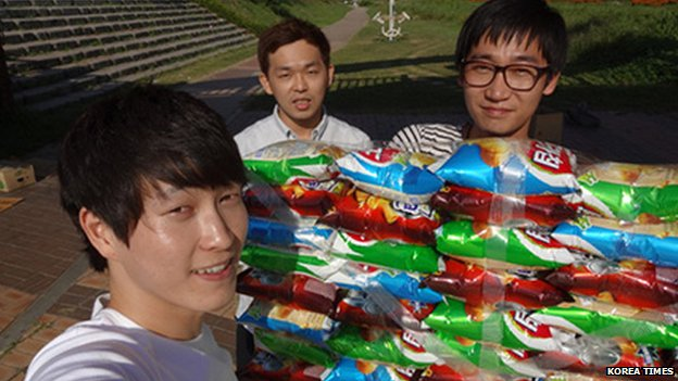 Korean students with their crisp packet boat