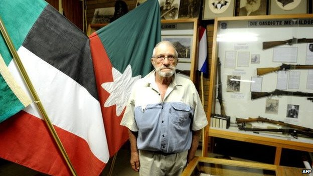 South African Afrikaner curator of Orania Museum, Gideon de Kock poses on 17 April 2013 in Orania