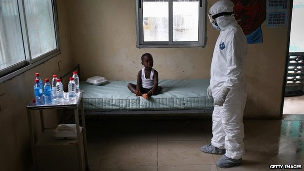 A health worker speaks to a quarantined boy at a hospital in Monrovia, Liberia - 3 October 2014