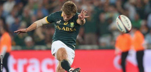 Patrick Lambie of South Africa kicks the match-winning penalty
