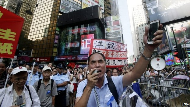 Elderly protesters shout slogans during ongoing protests in Causeway Bay, Hong Kong - 5 October 2014