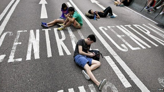 Pro-democracy protesters take a rest during ongoing demonstrations in Hong Kong - 5 October 2014
