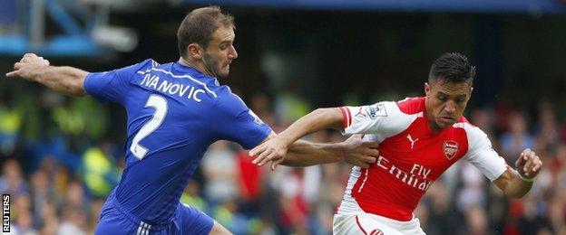Chelsea defender Branislav Ivanovic challenges Arsenal forward Alexis Sanchez