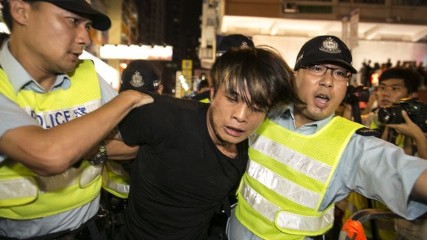 A protester gets arrested by police in the Mongkok neighbourhood as tensions rise between pro-democracy protesters and pro-Beijing on 3 October 2014 in Hong Kong