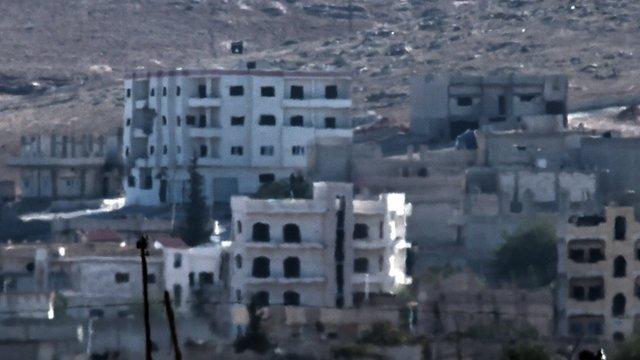 78041922 kobane Street battles as IS enters key town
