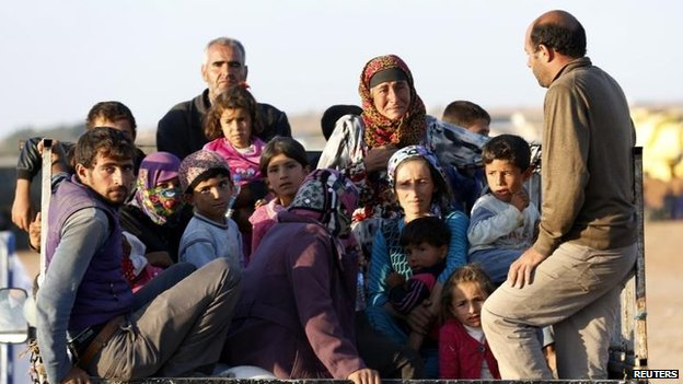 A truck loaded with civilians approaches the Turkish border, 6 Oct