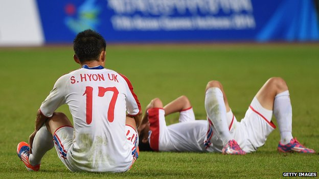 Dejected North Korean players after losing the Asian Games football final