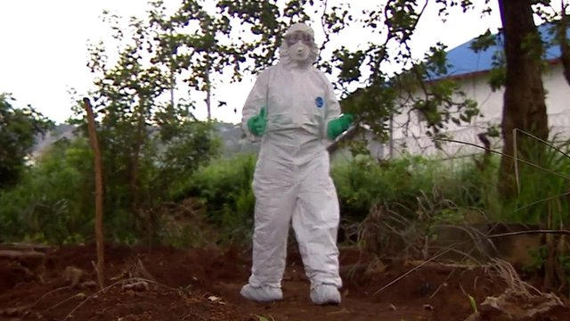 The BBC's Tulip Mazumdar in full biohazard kit reporting from Sierra Leone