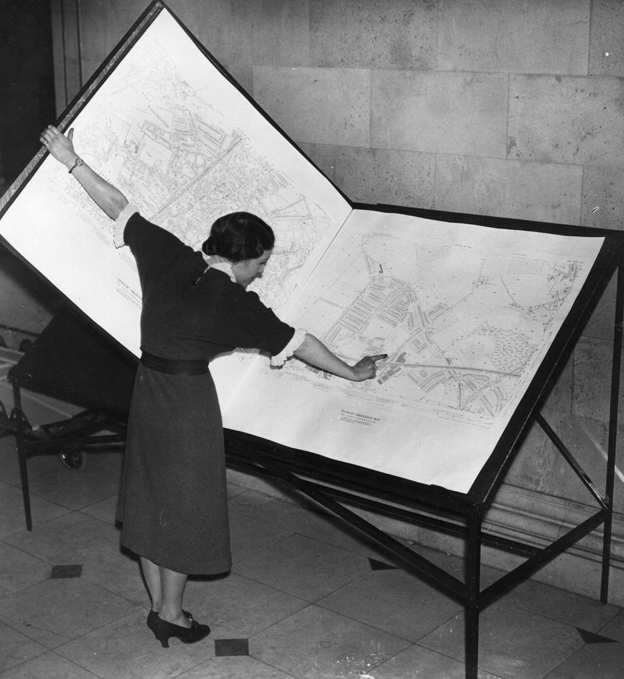 Woman looking at map 1937