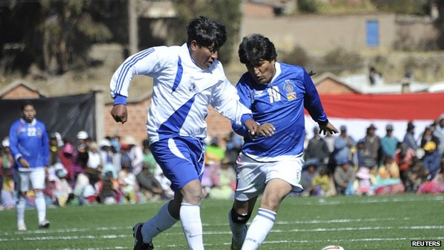 President Morales in a friendly soccer match held at the inauguration of a sport field at Lake Titicaca. 28 July 2014